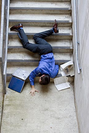 This picture is a simulation of what it may look like when a man falls down stairs. Slip and fall accidents, sometimes referred to as trip and falls, are covered by an area of law called premises liability. Contact a Lake Charles premises liability attorney today to represent you in your slip & fall injury claim.
