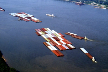 This is a fleet of barges like those that float up and down the Mississippi River. If you were injured on a barge near Lake Charles or in Southwestern Louisiana, call a Lake Charles Maritime Attorney today.